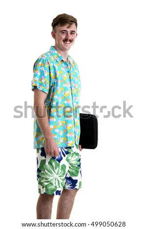Young man in Hawaii dress with tablet computer during tropical beach vacation