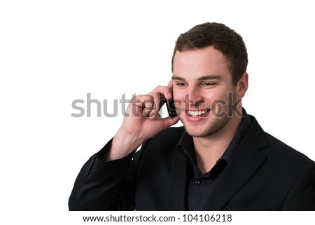 Young Man in jacket talking on the phone and smiling