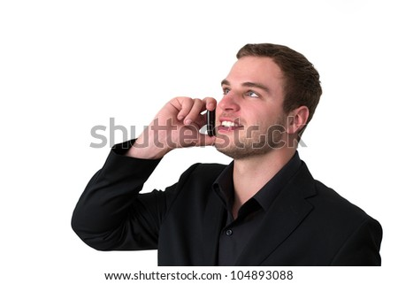 Young Man in jacket talking on the phone and smiling - stock photo