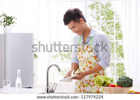 young man in kitchen - stock photo