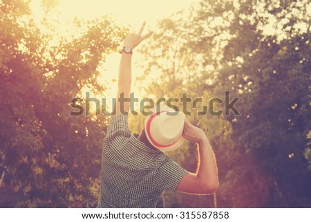 Young man in nature. - stock photo