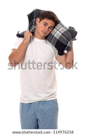 Young man in pajamas. Studio shot over white. - stock photo