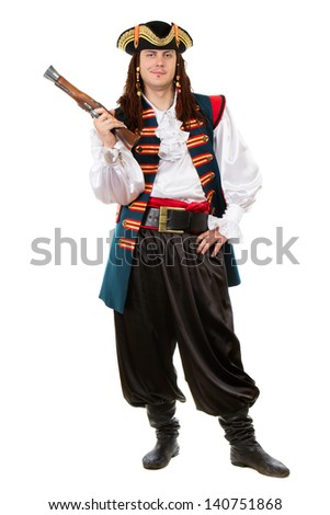 Young man in pirate costume posing with a pistol. Isolated on white