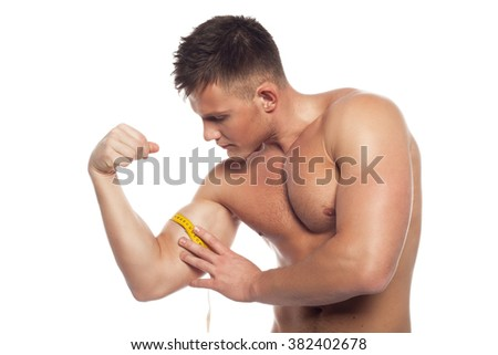 young man in profile shows a trained biceps