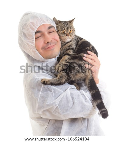 Young man in protective clothing holding a cat, isolated on white background - stock photo