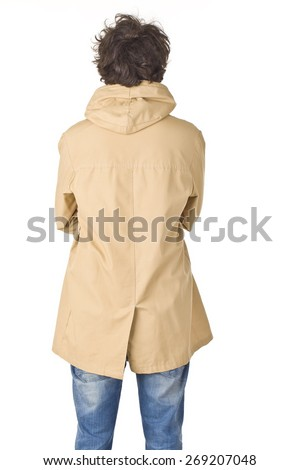 Young man in raincoat back portrait. - stock photo