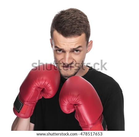 Young man in red boxing gloves. On a white background.
