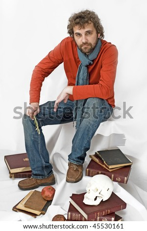 young man in red  t-shirt with books