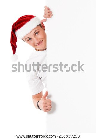 Young man in Santa hat - stock photo
