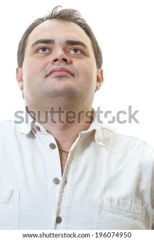Young man in shirt is isolated on white background.