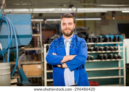 Young man in shoes factory.