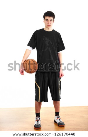 Young man in sportswear holding basketball in his hands. - stock photo