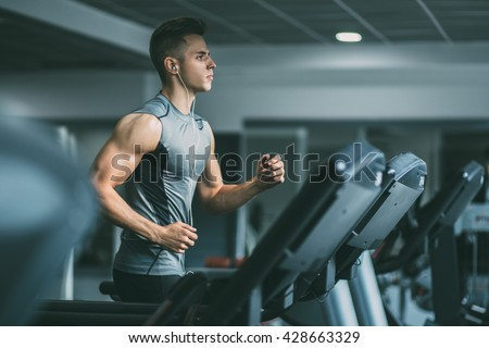 young man sportswear running on treadmill stock photo