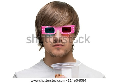 young man in stereo glasses with popcorn - stock photo