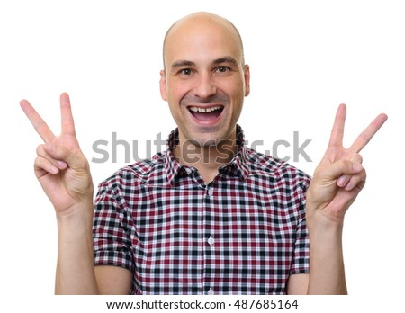 young man in stylish shirt while showing the victory sign and looking at the camera. Isolated on white background