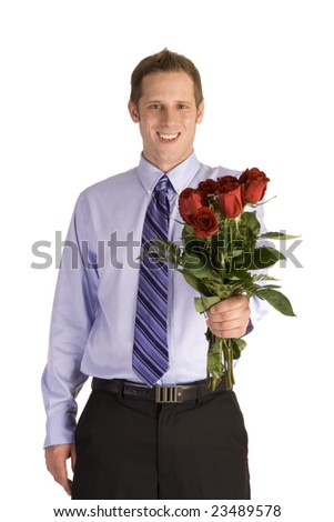 Young man in suit holding roses on white background.