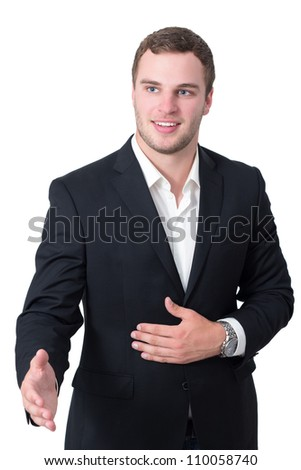 Young man in suit shaking hand - stock photo