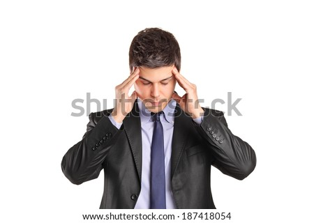Young man in suit trying to concentrate isolated on white background