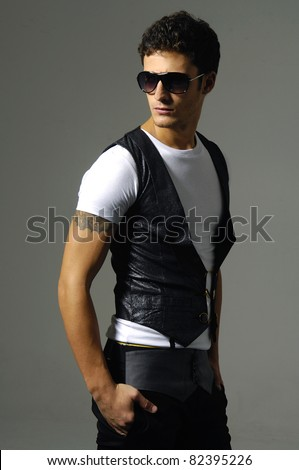 young man in sunglasses against shot in studio