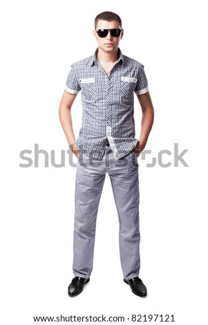 young man in sunglasses isolated on white background. Full length portrait - stock photo
