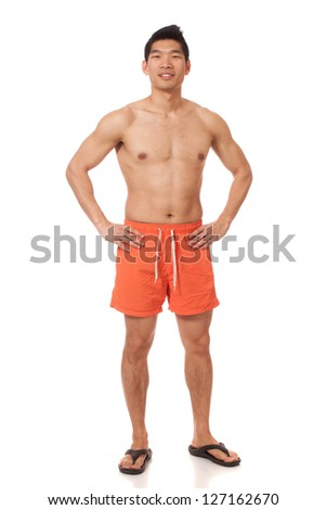 Young man in swimwear. Studio shot over white. - stock photo