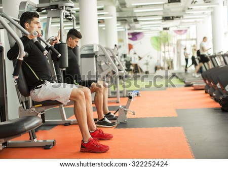 Young man in the gym - stock photo