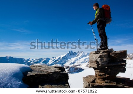 Young man in the mountains enjoying the view - stock photo