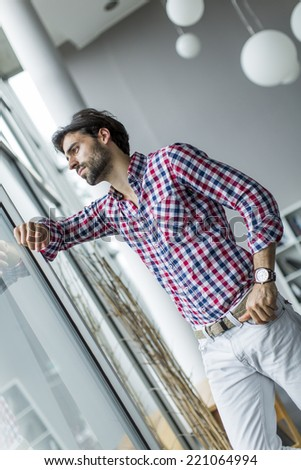 Young man in the office - stock photo