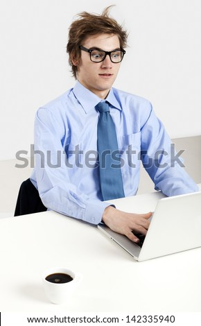 Young man in the office working in the laptop - stock photo