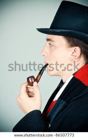 young man in top hat smoking a pipe