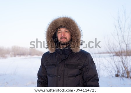 Young man in warm clothes