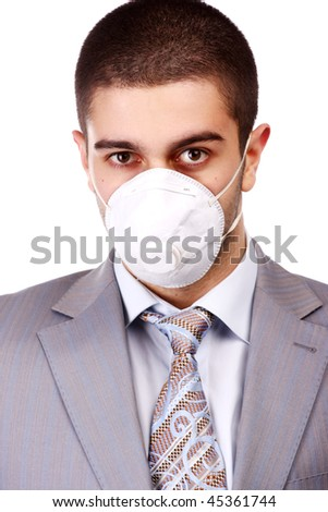 young man in white respirator and grey suit