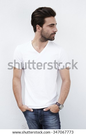 Young man in white t-shirt against white wall