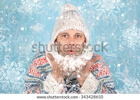 Young man in winter clothes on frozen cold background - stock photo