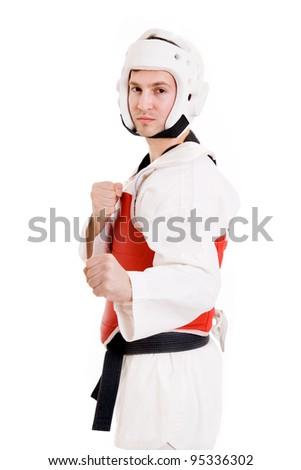 Young man inTaekwondo gear over white background. - stock photo