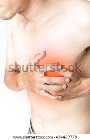 Young man is clutching his chest, acute pain possible heart attack , isolated on white background