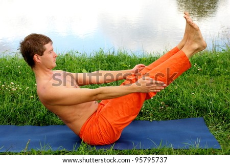 Young man is doing his yoga practice