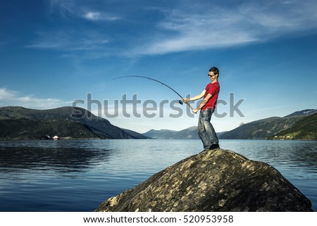 Young man is fishing in Norway