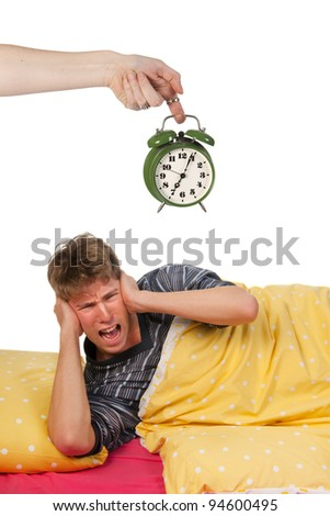 Young man is hating to wake up - stock photo