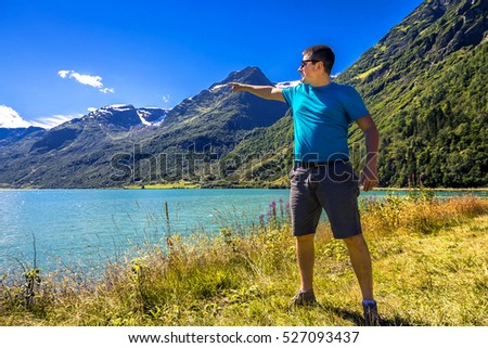 Young man is having fun hiking in Norway