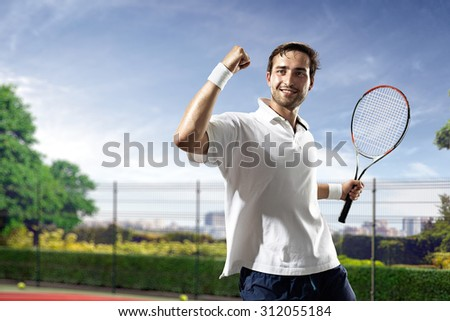 Young man is playing tennis on sunny day - stock photo