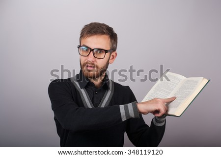Young man is surprised because of something he had read in a book