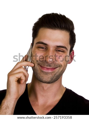 Young man is talking happy on the phone - Young adult is happy while talking on the telephone. - stock photo