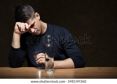 Young man is very addicted and lonely  - stock photo