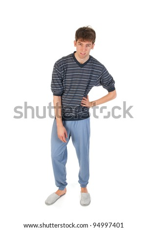 Young man is wearing pajamas and slippers - stock photo