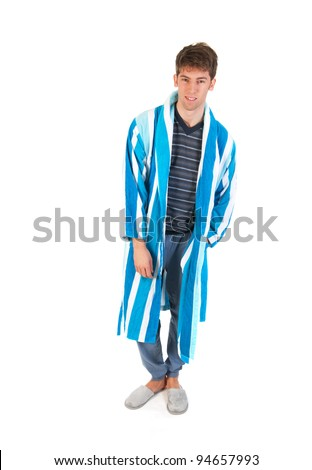 Young man is wearing pajamas gown and slippers - stock photo