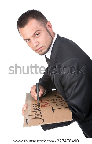 Young man is writing sign tablet for job search. Looking at the camera. - stock photo