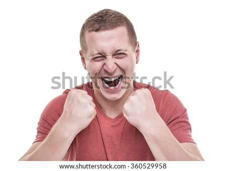 Young man isolated on white background, rejoices victory. - stock photo