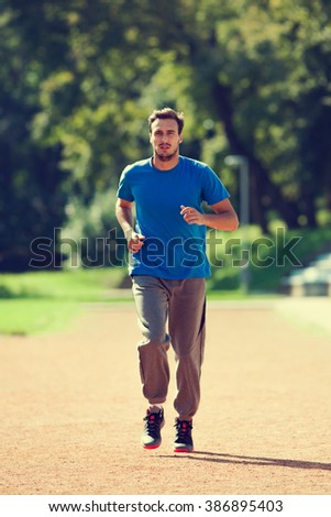 Young man jogging, intentionally toned image.