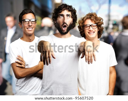 young man joking with friends at crowded place